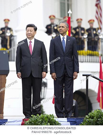 United States President Barack Obama and President XI Jinping of China participate in an arrival ceremony during an official State Visit on the South Lawn of...