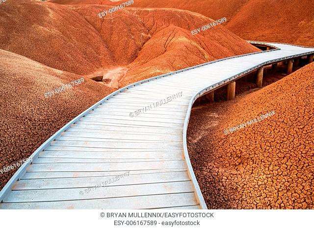 Wooden raised walkway through the Red Hills of the Painted Hills Unit of the John Day Fossil Beds National Monument, Oregon