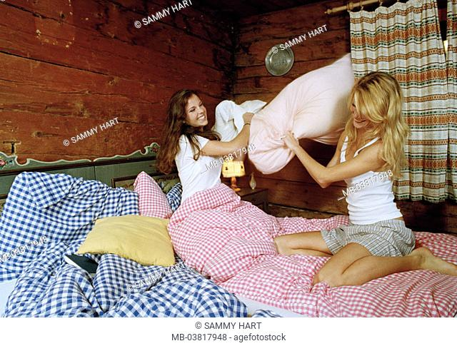 Almhütte, women, two, young, underwear,  Bed, fun, pillow battle, cheerfully, laughing,   Series, friends, 20-30 years, blond, dark-haired, Alm, cottage