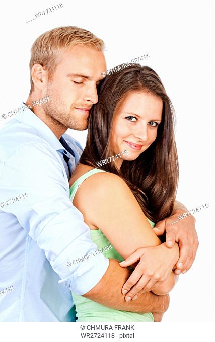 Portrait of a Happy Young Couple Smiling Looking - Isolated on White