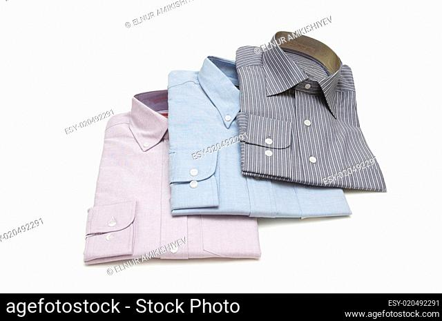 Three packed shirts isolated on white