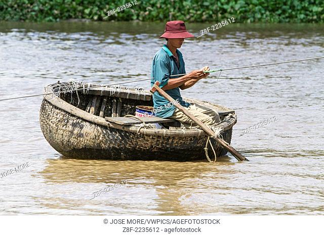 Traditional boats carry freight on the Mekong River, Vietnam