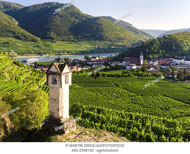Wayside shrine near old town gate Rote Tor in the village Spitz, which is nested in the vineyards of the Wachau. The Wachau is a famous vineyard and listed as...