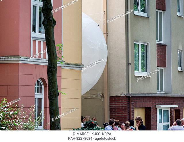 A kind of bubble can be seen between two houses in Bochum, Germany, 23 July 2016. OnFriday, architecture students in Bochum began an experiment on the future...