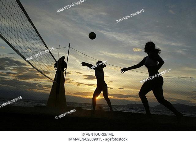 Women playing volleyball on beach, Greece, Peloponnese, Corinthia, Loutraki