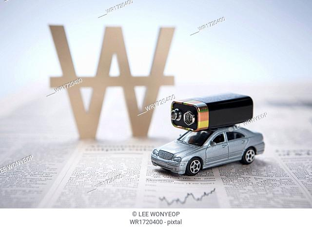 A car with a battery on the roof