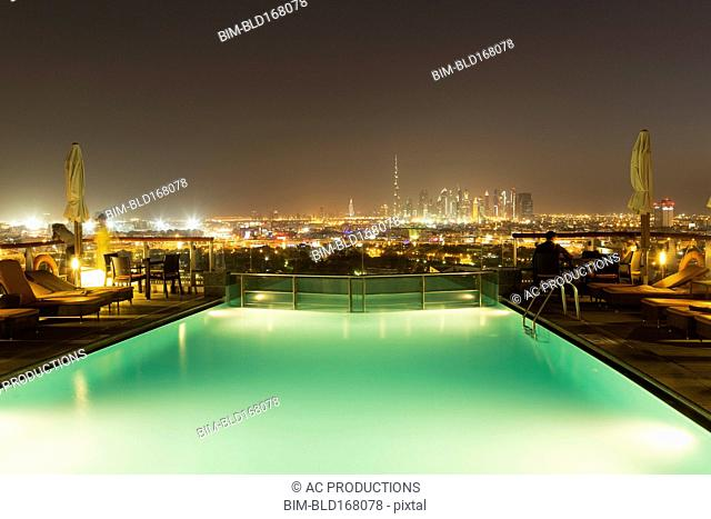 Swimming pool over cityscape at night, Abu Dhabi Emirate, United Arab Emirates