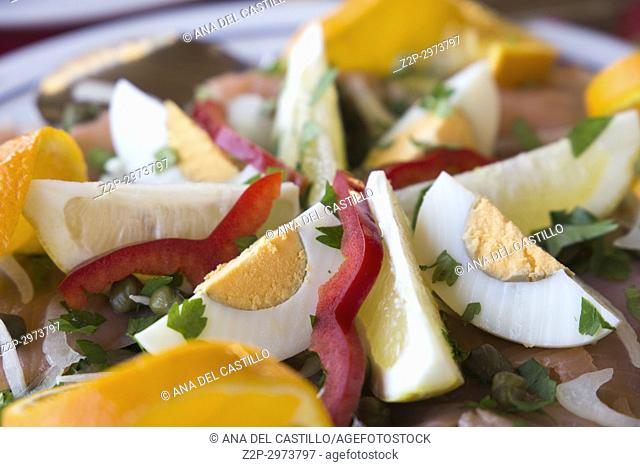 Salad with salmon boiled eggs and orange