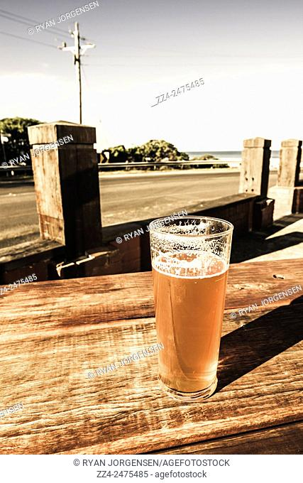 Pale ale beer on a wooden table on the Victorian Great Ocean Road tourist destination strip. One for The Great Ocean Road