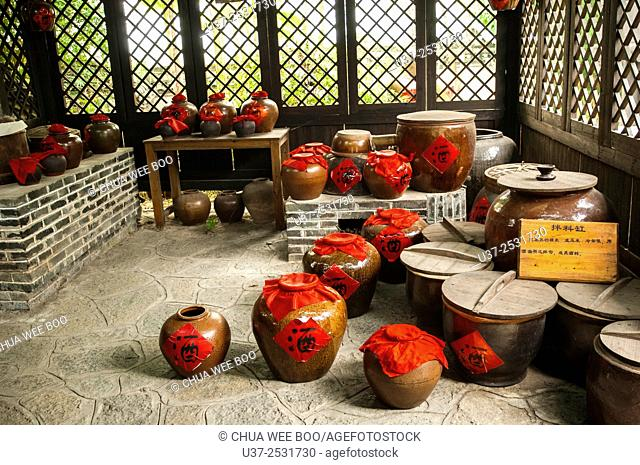 China, Guangxi Province, Guilin, Yangshuo, many wine jars in the farmhouse