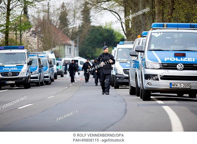 Police officers secure a street in Dortmund, Germany, 12 April 2017. Three explosions occurred near the road blockade next to the team bus of the Borussia...
