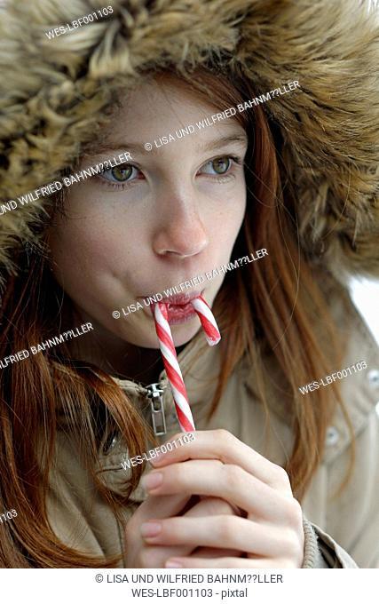 Girl enjoying candy cane