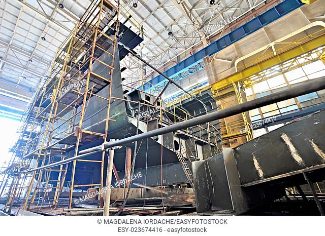 Ship building and scaffolding in a shipyard