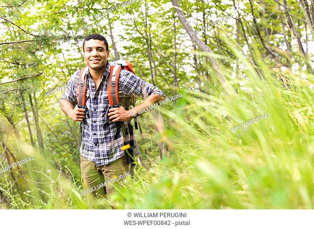 Italy, Massa, portrait of young man hiking in the Alpi Apuane mountains