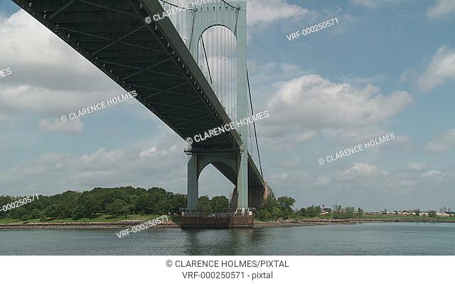 The view from a boat sailing under the Bronx-Whitestone Bridge on the East River in New York City