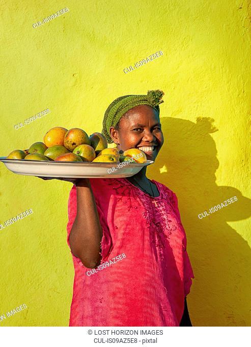 Ethiopian woman selling mangoes, Addis Ababa, Ethiopia