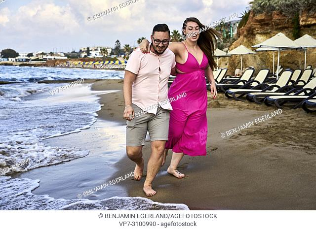 Chersonissos, Crete, Greece, couple walking on beach, vacations