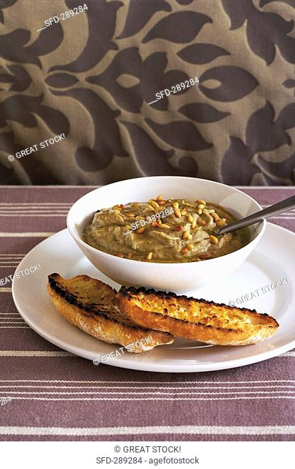 Aubergine and garlic dip with pine nuts, toasted bread