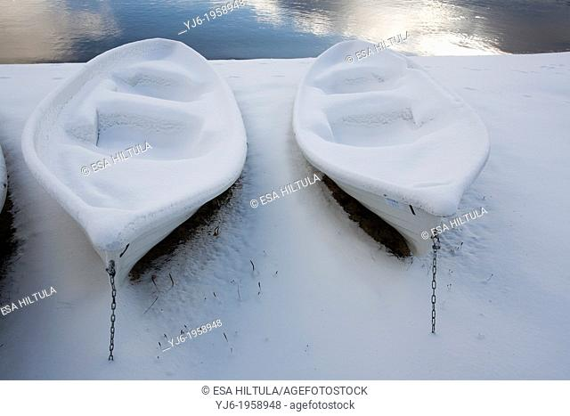 rowboats covered in snow, Finland