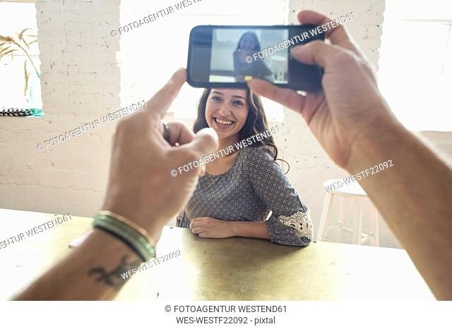 Cell phone shot of smiling young woman