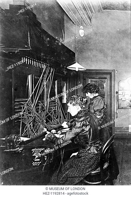 GPO telephone exchange, London, c1905. Female telephonists at the switchboard. The first of the General Post Office's (manual) telephone exchanges opened in...