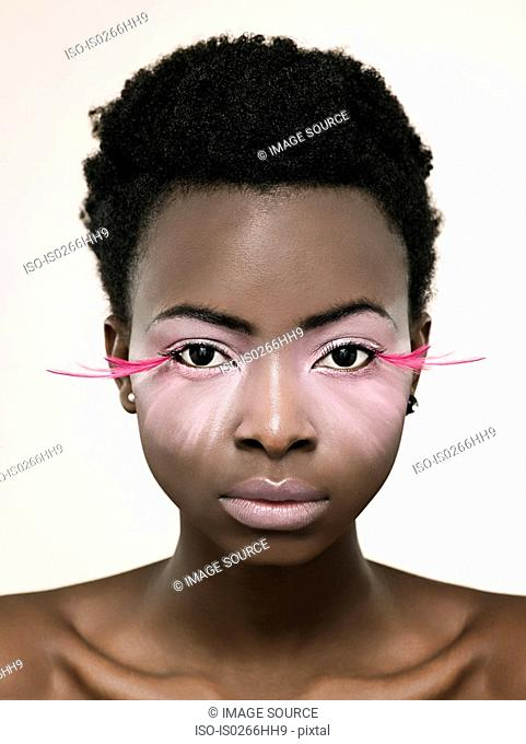 Portrait of a woman wearing pink false eyelashes