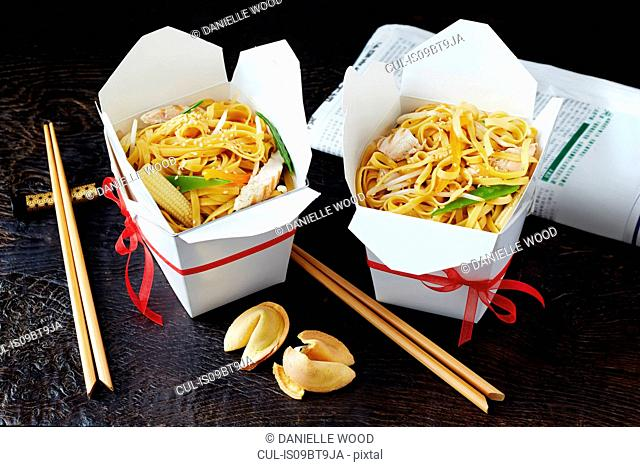 Still life with chinese noodles in takeaway boxes, asian takeaway food