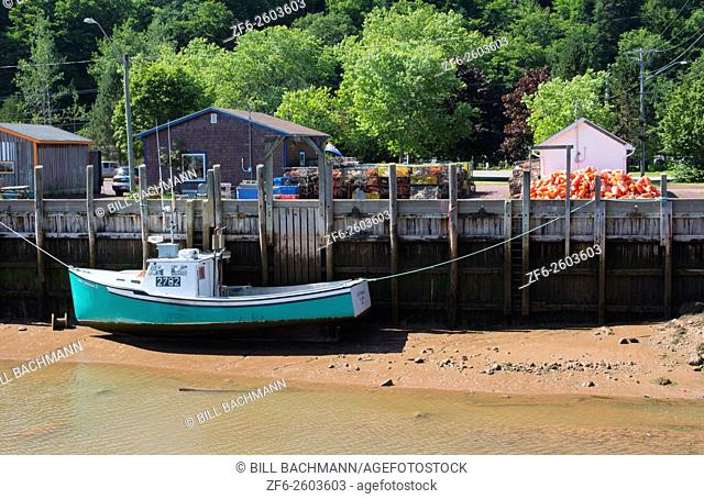 Canada St Martins New Brunswick small fishing village with fishing lobster boat in harbor