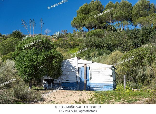 Wooden hut. Decorated with colors typical of the Algarve. Cancela Velha. Portugal