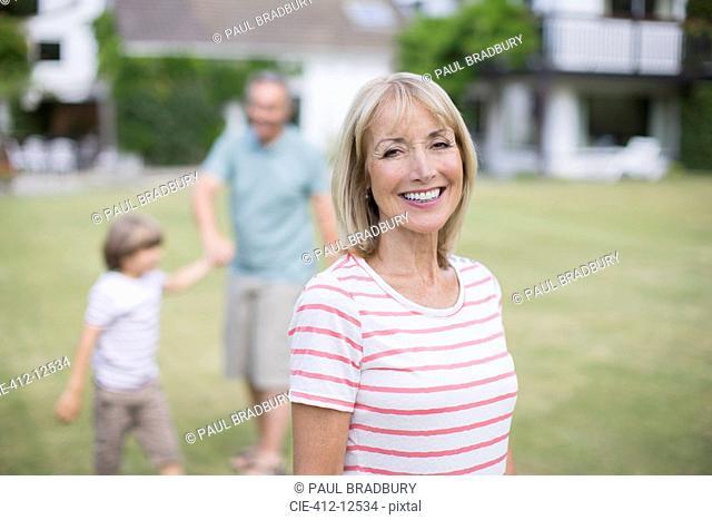 Grandparents and grandson in backyard
