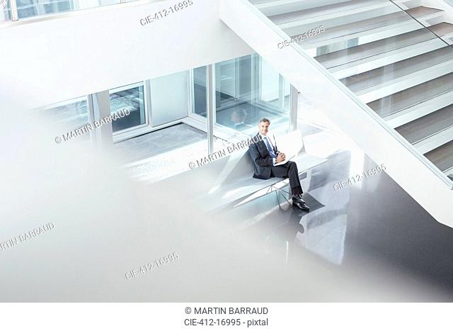 Businessman sitting in modern lobby