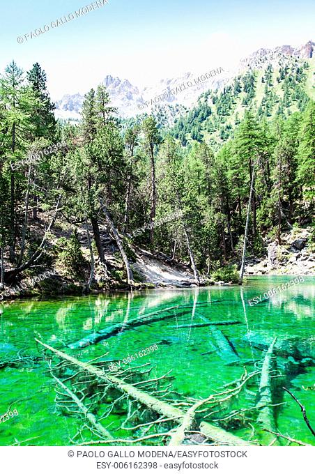 Bardonecchia, Italy. The Green Lake, Alpine lake with fluo color due to a local seaweed