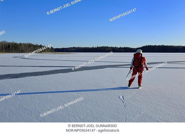 A woman skating on a lake, Alsjon, Regna, ostergotland, Sweden