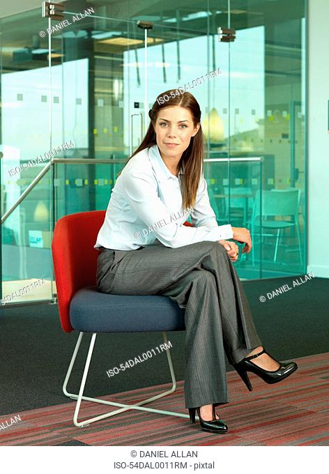 Businesswoman smiling in chair