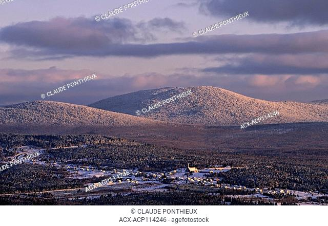 Late afternoon view of White Mountains and the village of Notre-Dame-des-Bois in winter from Mont-Mégantic, Québec, Canada