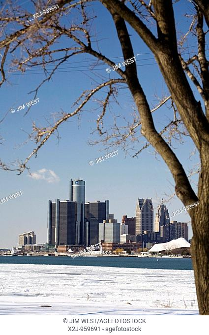 Detroit, Michigan - Downtown Detroit and partially-frozen Detroit River in winter  General Motors headquarters in the Renaissance Center is in the tall