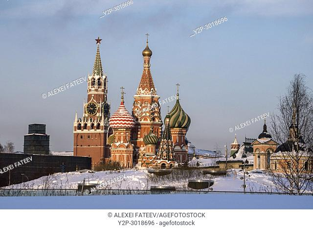 View of Kremlin' Spasskaya Tower and St. Basil Cathedral from Zaryadye park in Moscow, Russia