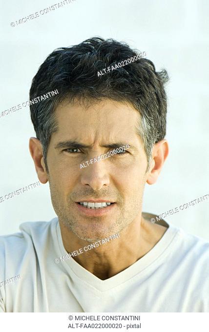Man snarling at camera, portrait