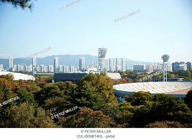 Skyline in daytime, national park and sports stadium in foreground, Seoul, South Korea