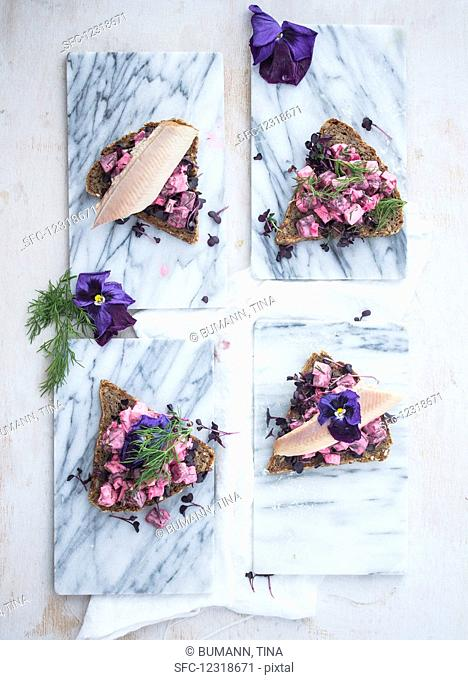 Danish Smörrebröd with beetroot salad and smoked trout (top view)