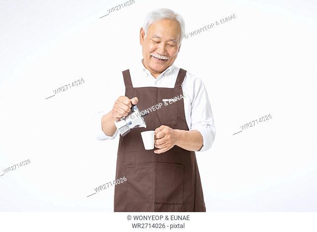 Smiling senior male barista