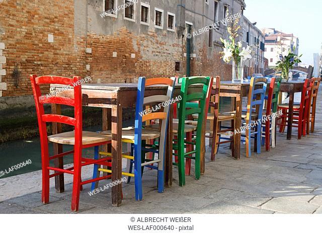 Italy, Venice, Cannaregio, street restaurant at Rio de la Misericordia, empty chairs