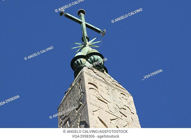 Close Up from below to the Egyptian Obelisk (Ramses II) in Piazza del Popolo in the city of Rome, Italy