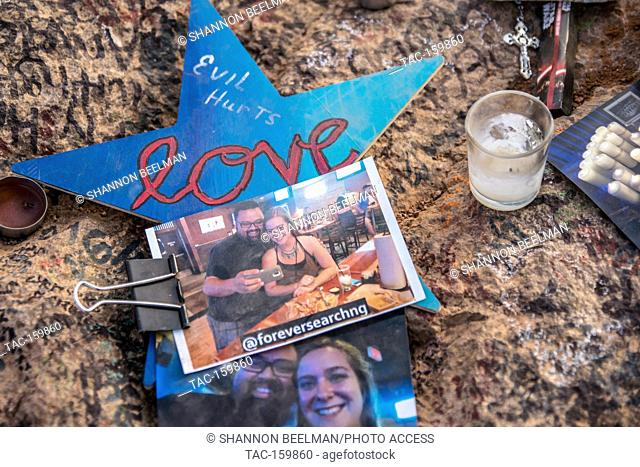 Visitors set up memorials to those lost in the Route 91 Shooting at the Welcome to Las Vegas Sign two weeks after the shooting in Las Vegas, NV