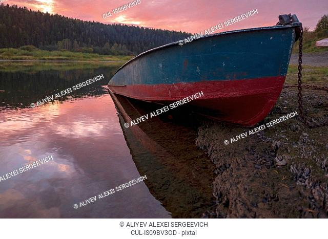 Boat on river bank, Ural, Sverdlovsk, Russia