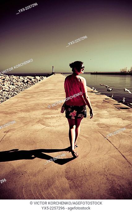 Young woman at the lake shore