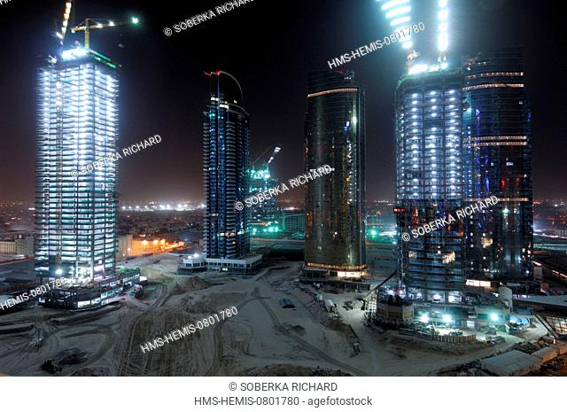 United Arab Emirates, Dubai emirate, Jumeirah, Cranes in action on the construction site buildings of Jumeirah Lake