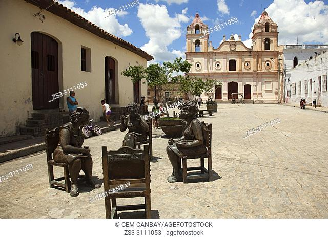 View to the Carmen Church-Iglesia de Nuestra Senora del Carmen and statues in Plaza Del Carmen Square at the historic center, Camagüey, Cuba, West Indies