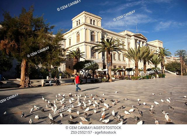 Pigeons in front of the Neo Classic City Hall of Ermoupolis in Miaoulis Square, Ermoupolis, Syros, Cyclades Islands, Greek Islands, Greece, Europe
