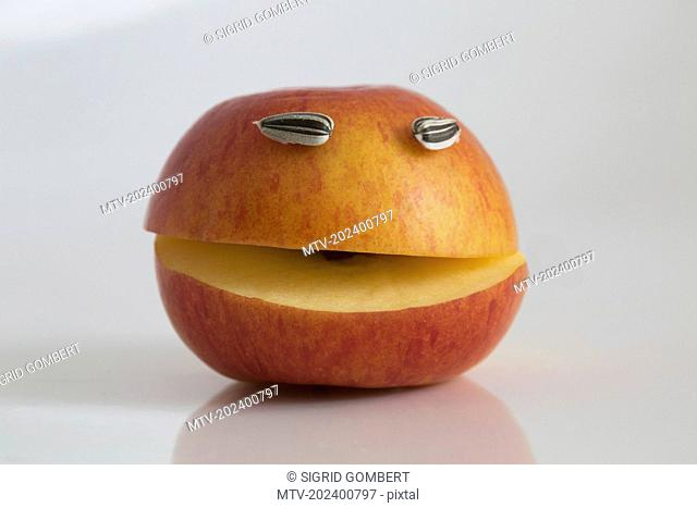 Close-up of apple with smiley face